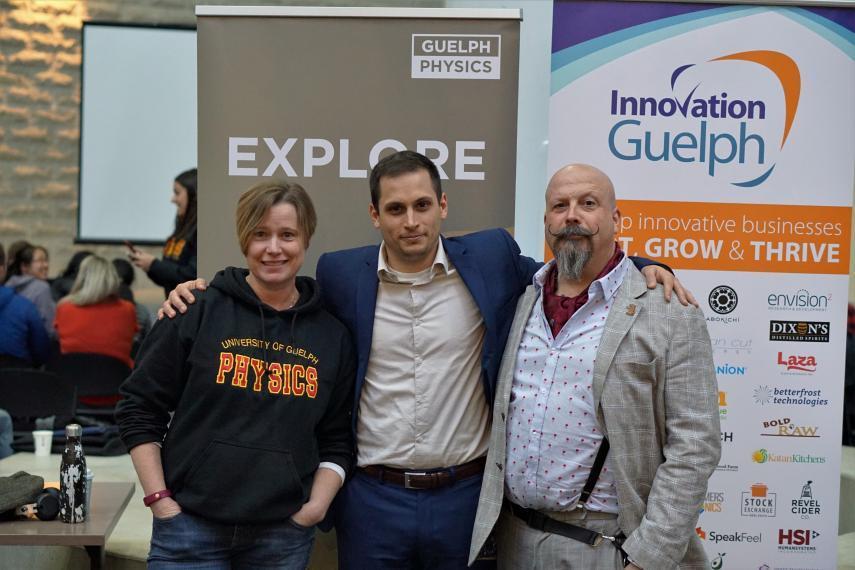 Joanne O'Meara, Scott VanBommel, Orbax in front of sponsor banners