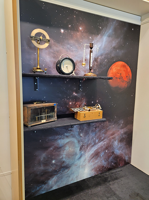 Display of physics instruments with a background of space