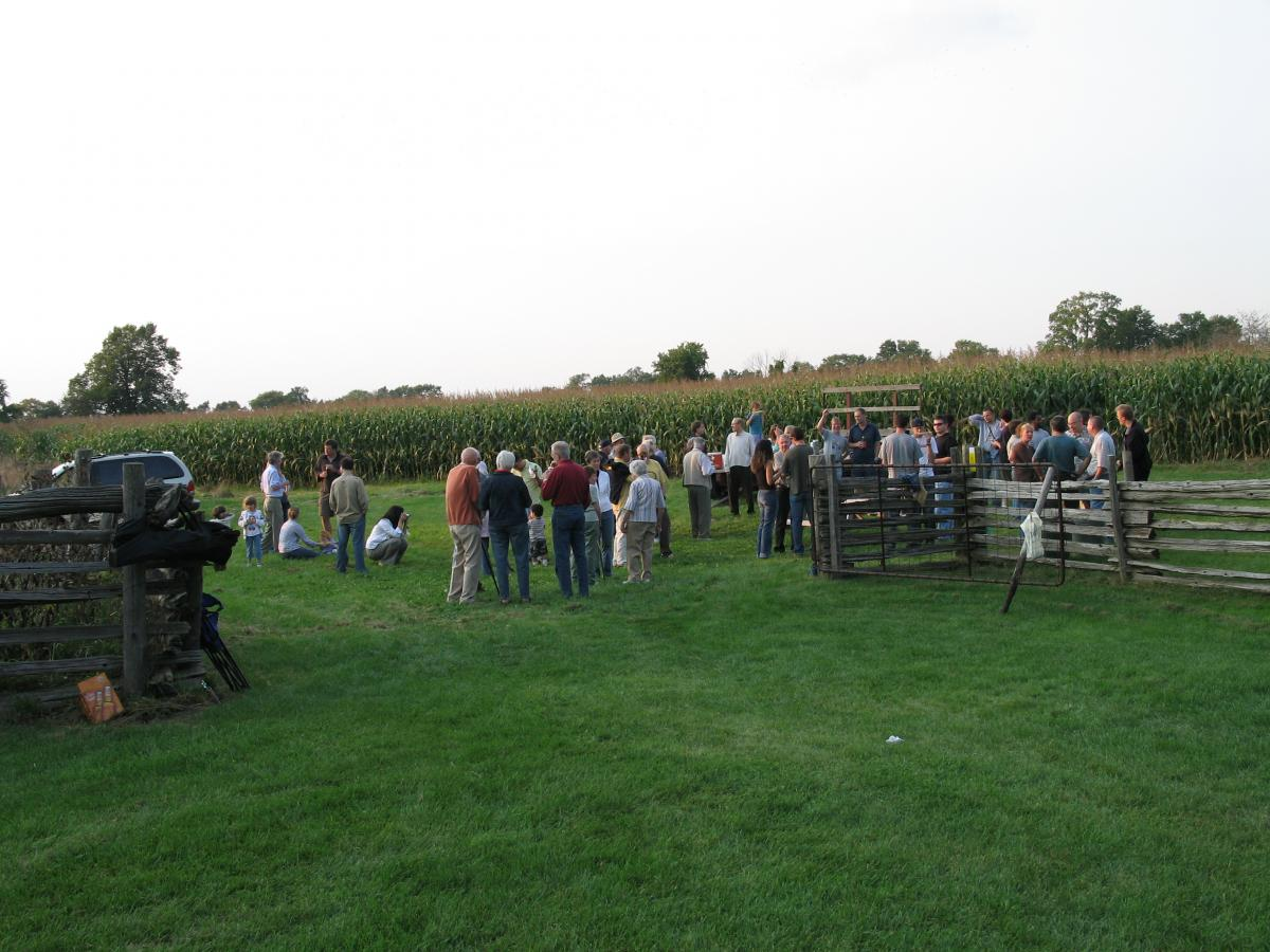 Members of the Physics family in 2006, gathered beside the corn field at the Stevens family farm, hosts of our annual corn roast for over 50 years.